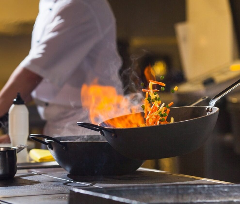 cook making dinner in the kitchen of high-end restaurant.