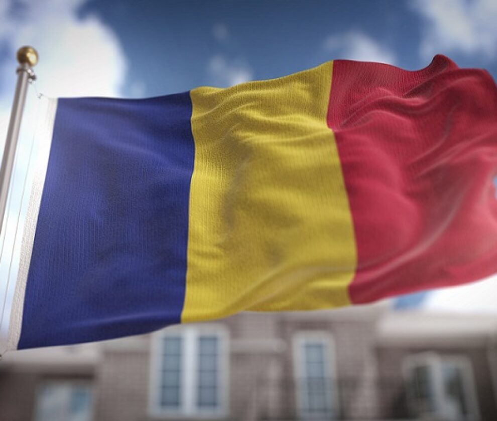 Romania Flag 3D Rendering on Blue Sky Building Background