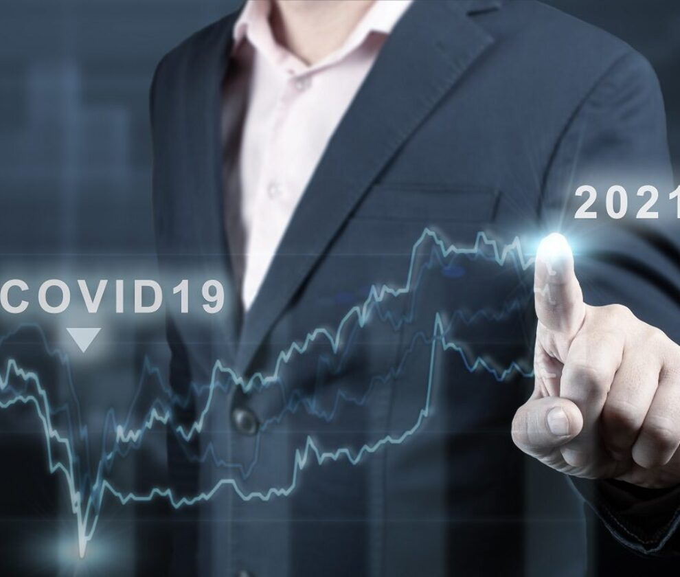 concept of economic recovery after the fall due to the covid 19 coronavirus pandemic. Financial graph 2021. Stock market chart. Businessman pointing graph. Return of growth after a fall
